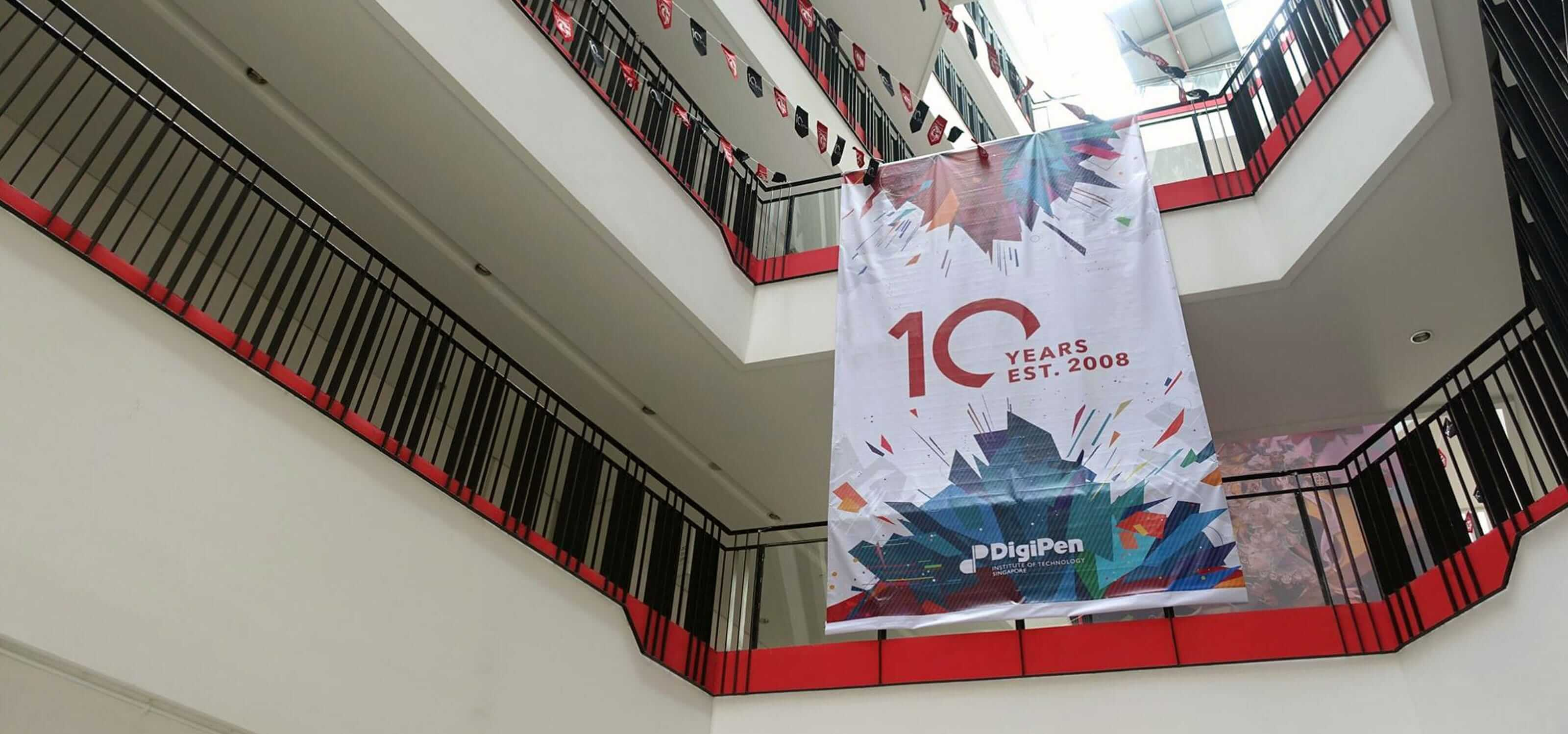 A banner hangs in the atrium of the DigiPen (Singapore) building celebrating the 10th anniversary