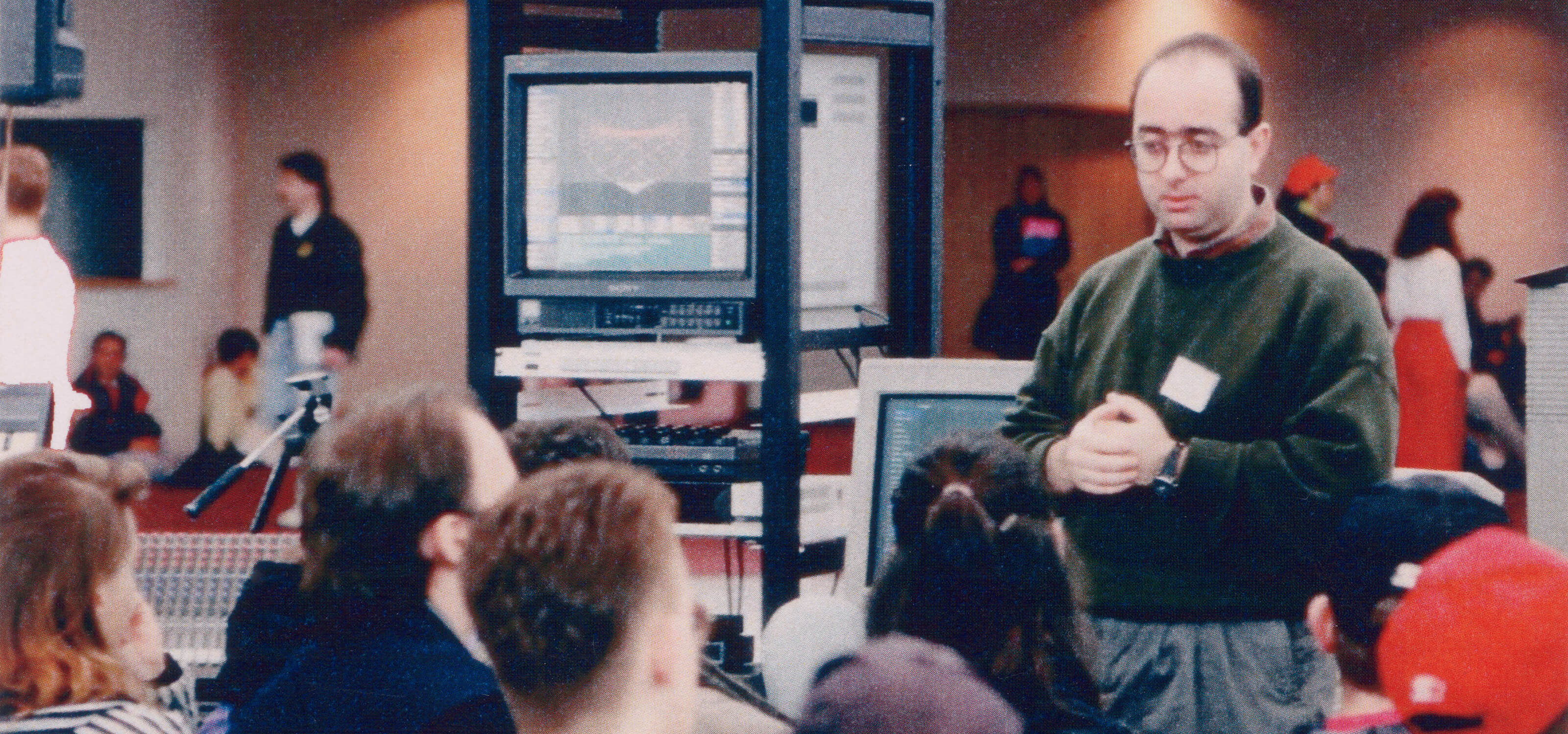 DigiPen founder and president Claude Comair speaks at a convention in 1989
