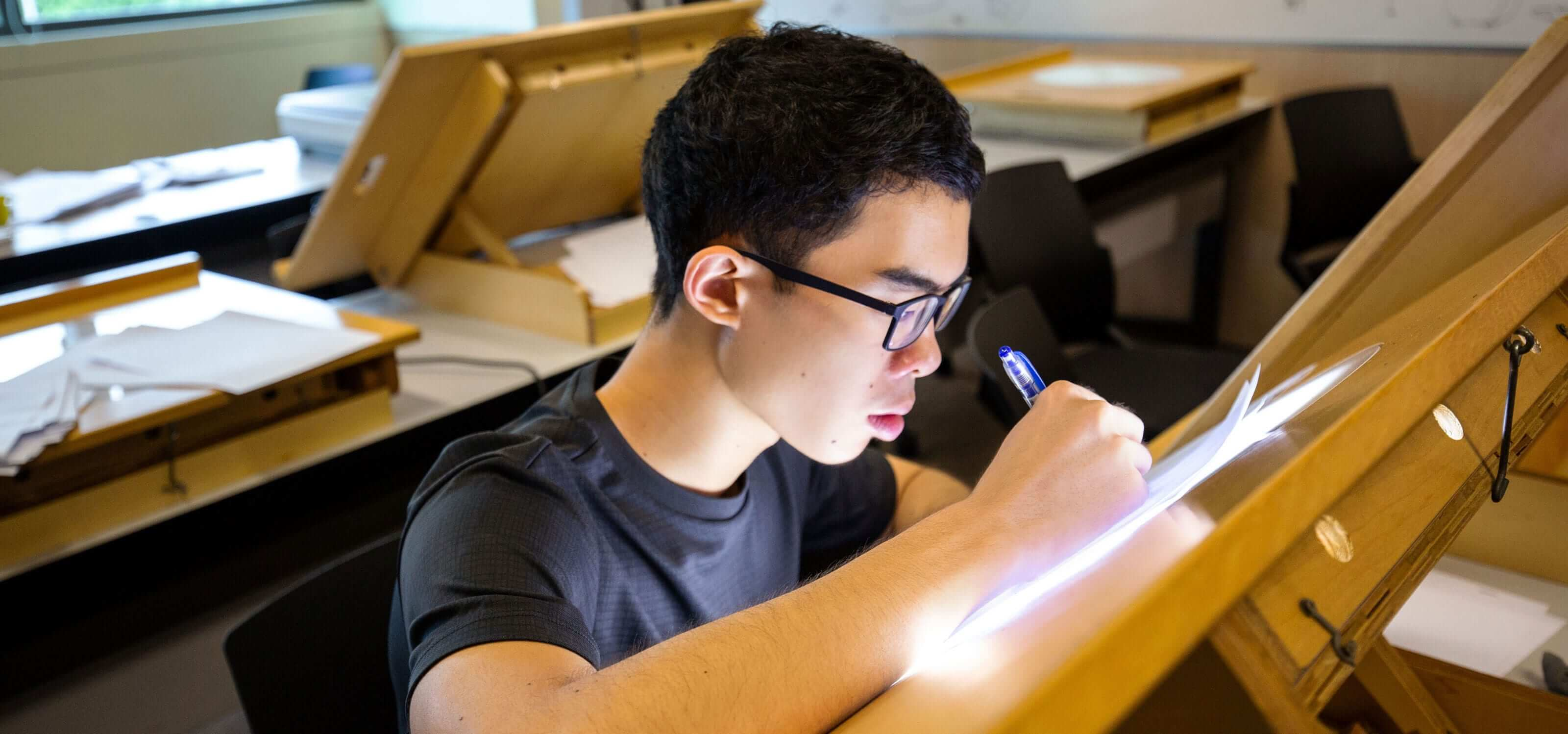 A DigiPen (Singapore) student concentrates as he works on an animation lightbox