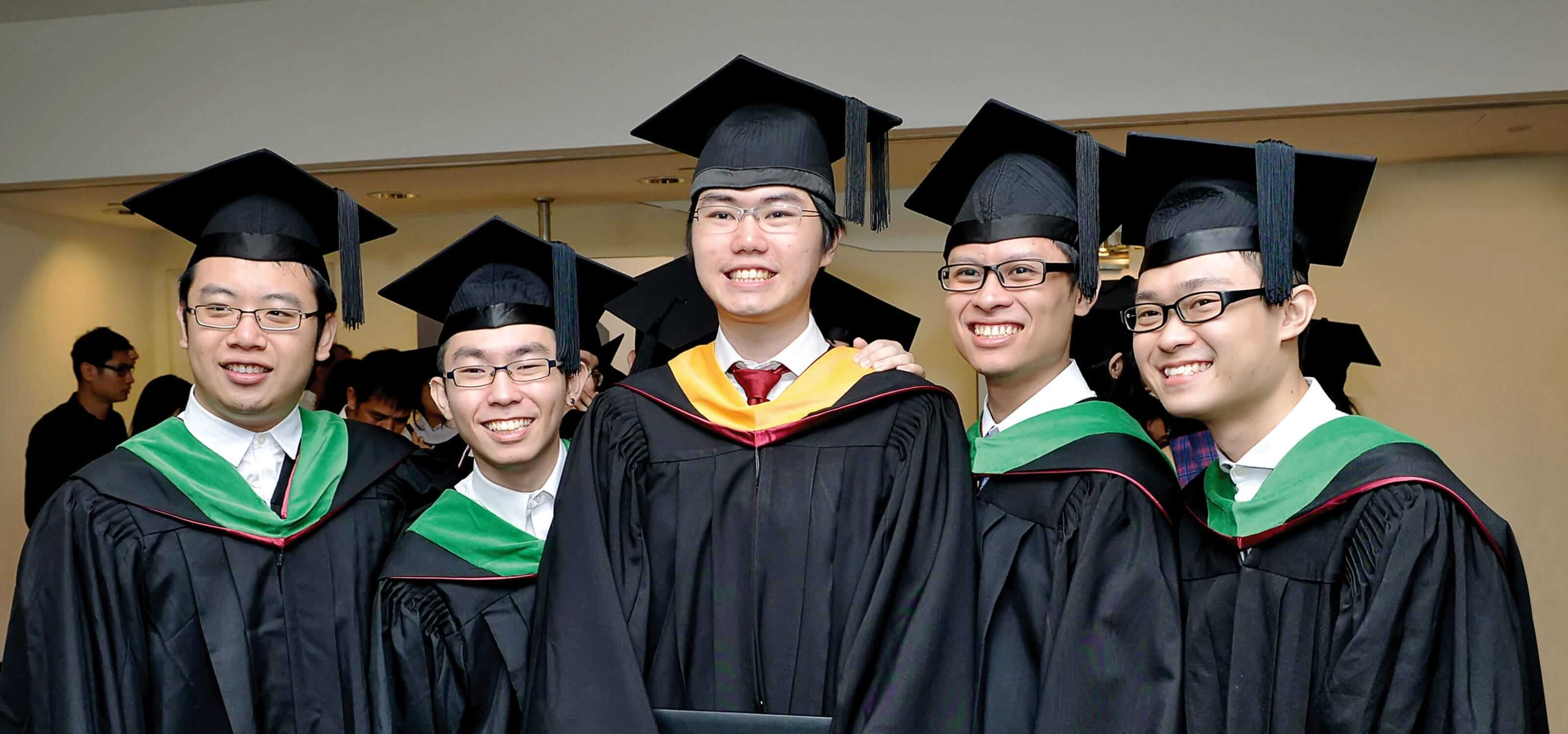 A group of DigiPen (Singapore) graduates smiling proudly at Commencement
