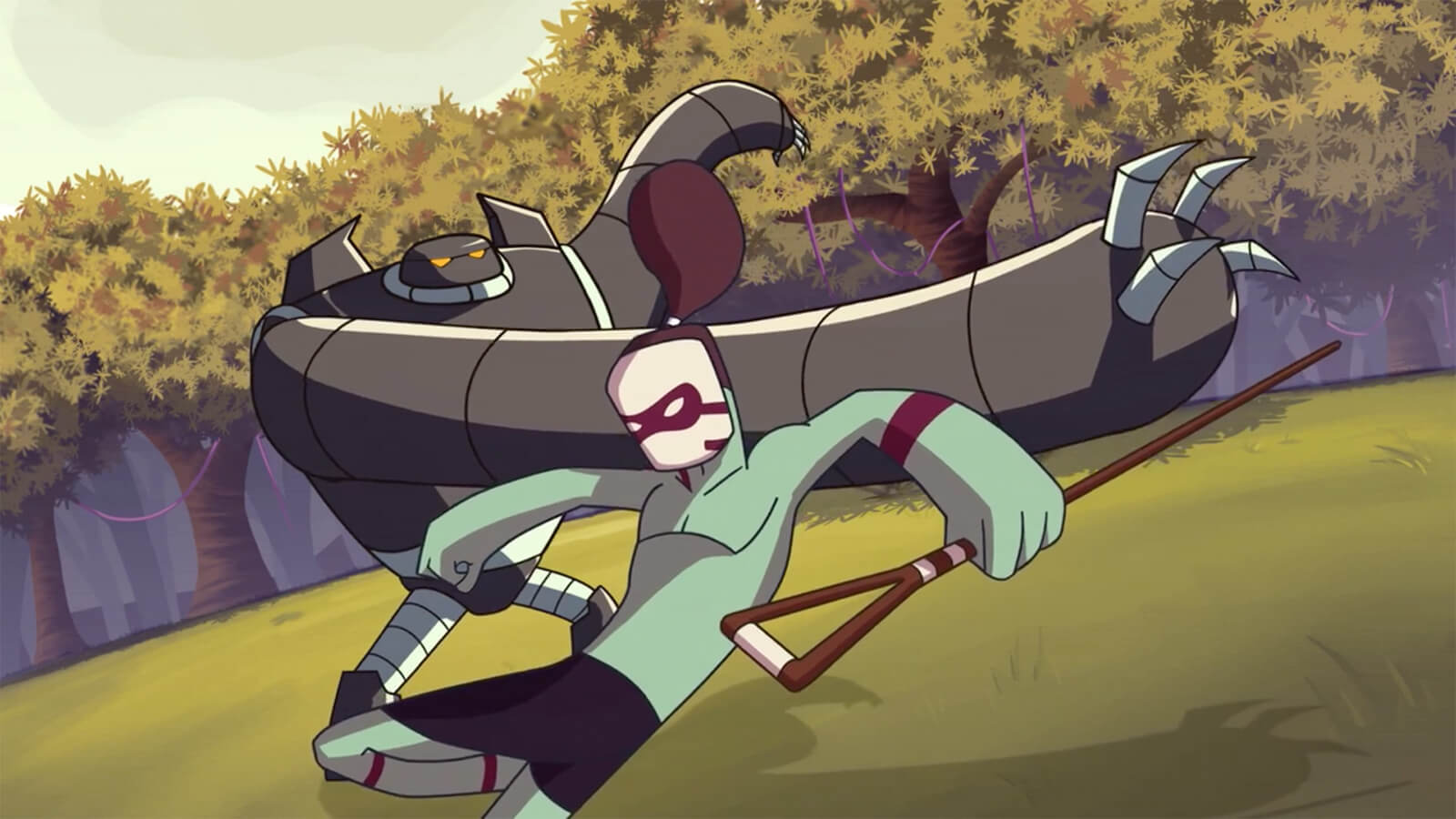 In a forest clearing, a green humanoid in a white-and-red mask dodges the swinging arm of a large, gray robot.