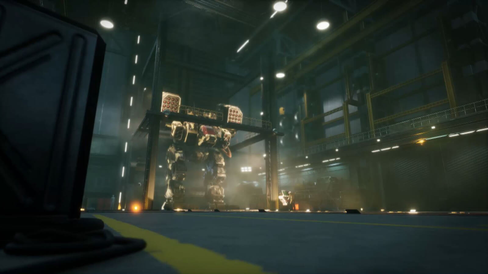 From a distance, a gigantic armored battle mech stands in a hangar.