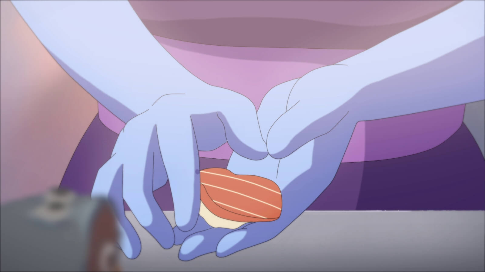 Hands holding a food item