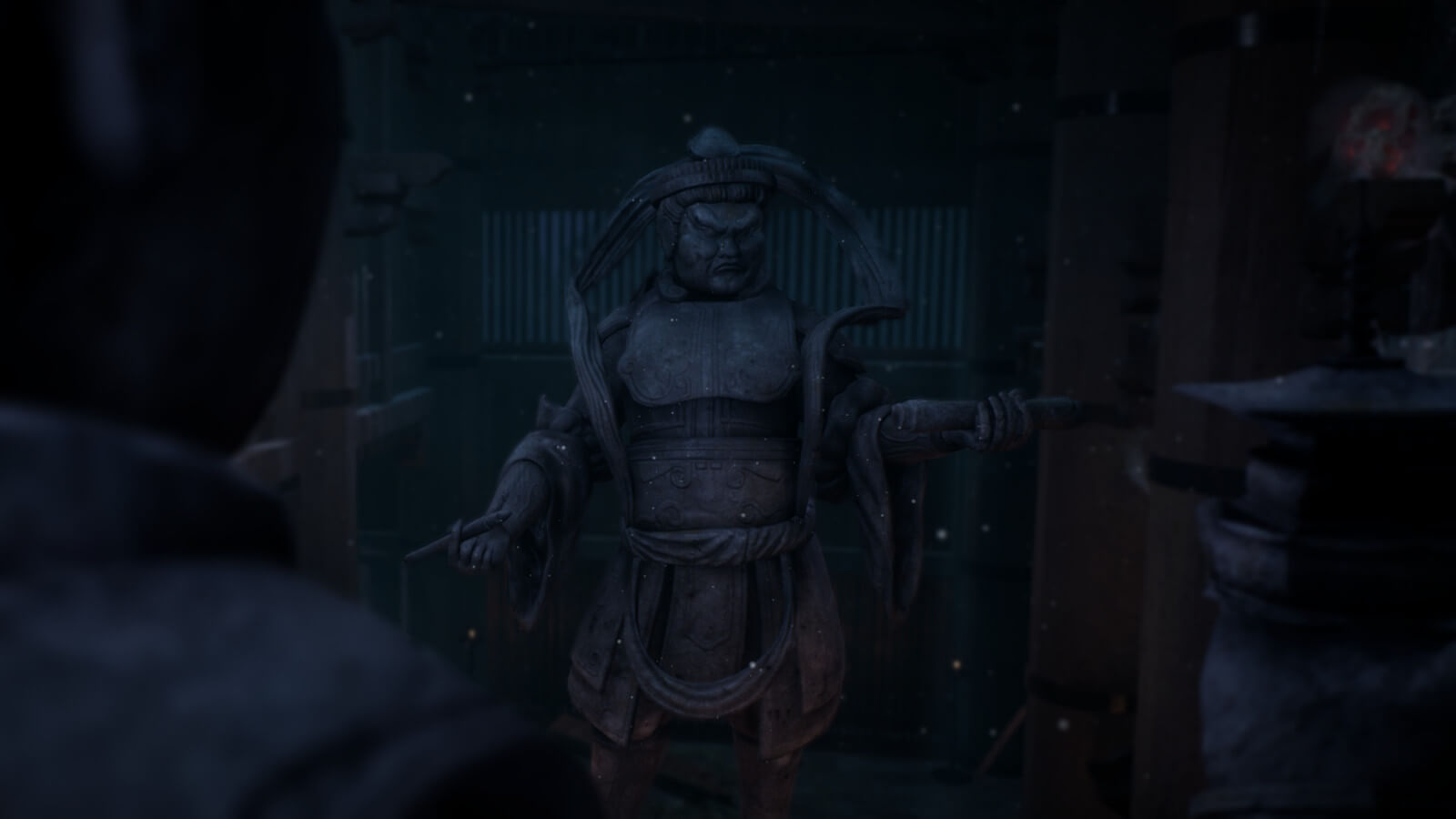 Statue in a dark room