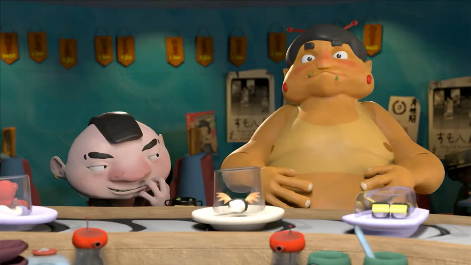 A short man looks mischievously at a shirtless sumo wrestler behind a line of conveyor belt sushi plates.