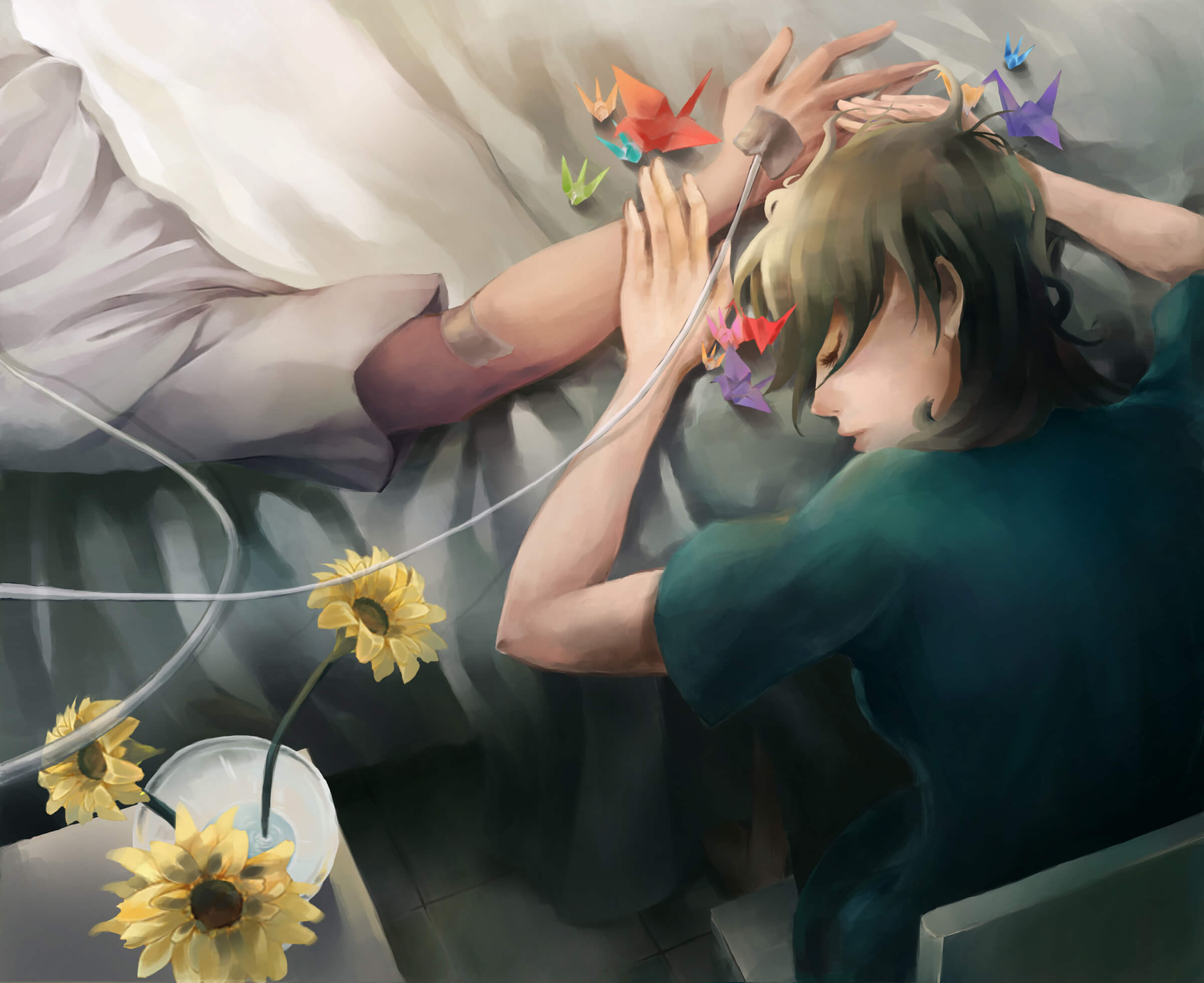 A girl rests her head against an arm of a person in a hospital bed, with several brightly colored paper cranes nearby.
