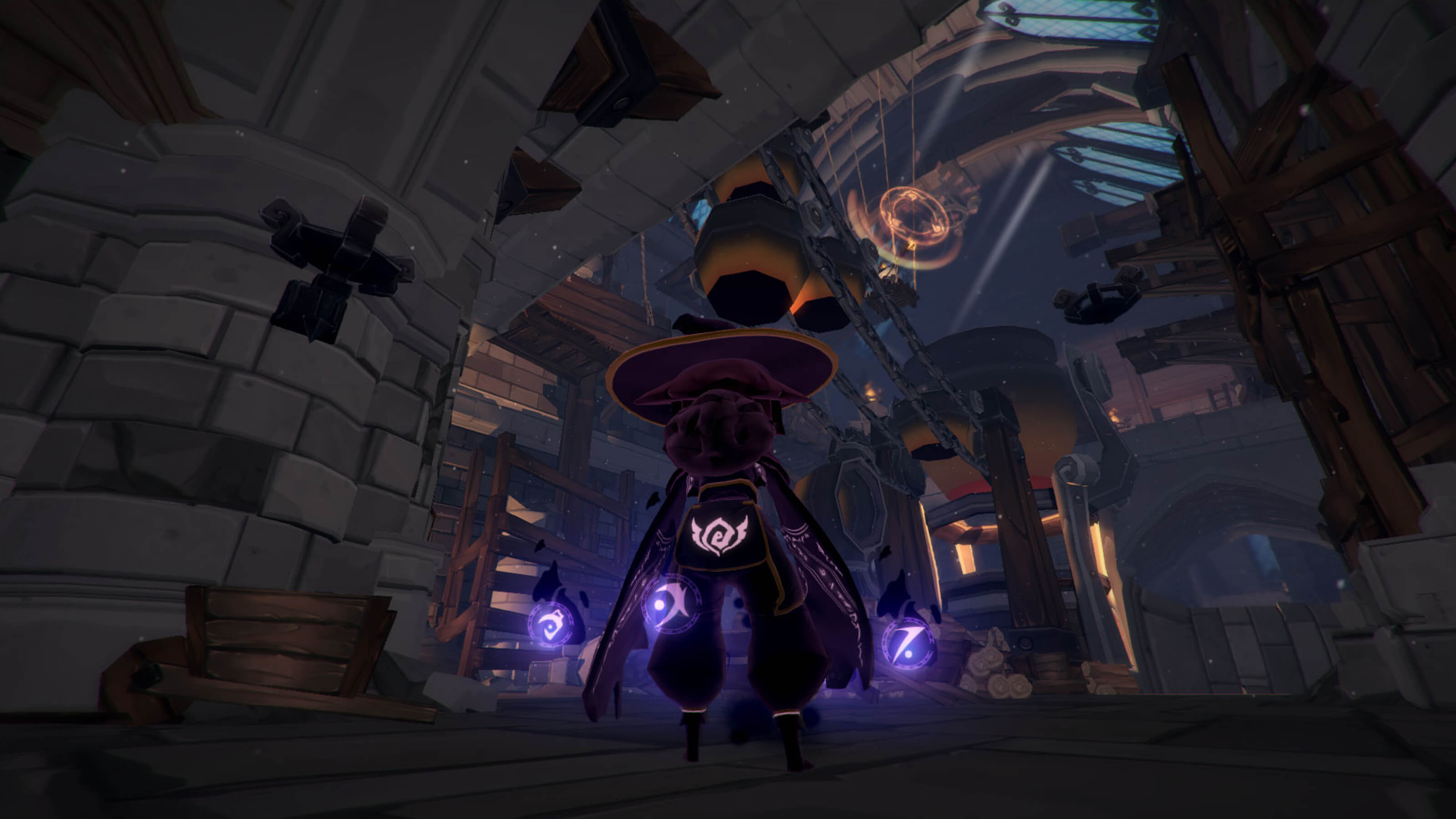 A view of the player's character in third person from behind as she stands in a large stone-and-wood structure
