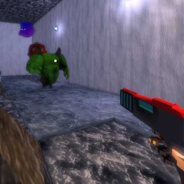 A gun is pointed toward a green ogre-like enemy from a first-person perspective in a rocky, underground environment