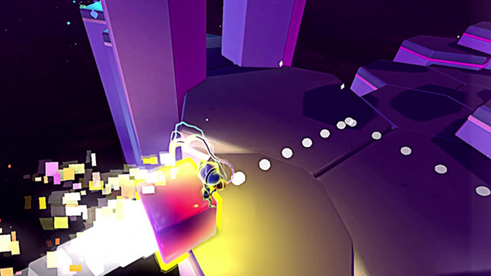 The player's character is propelled forward on a block as white spheres appear in front of it