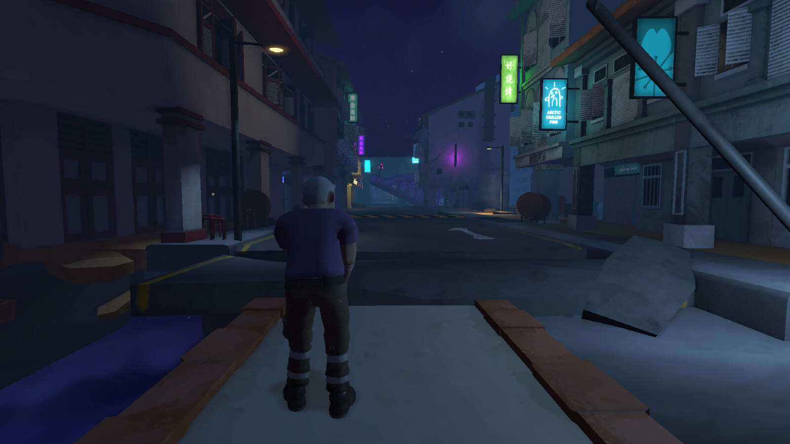 Man standing while looking up at dark empty street