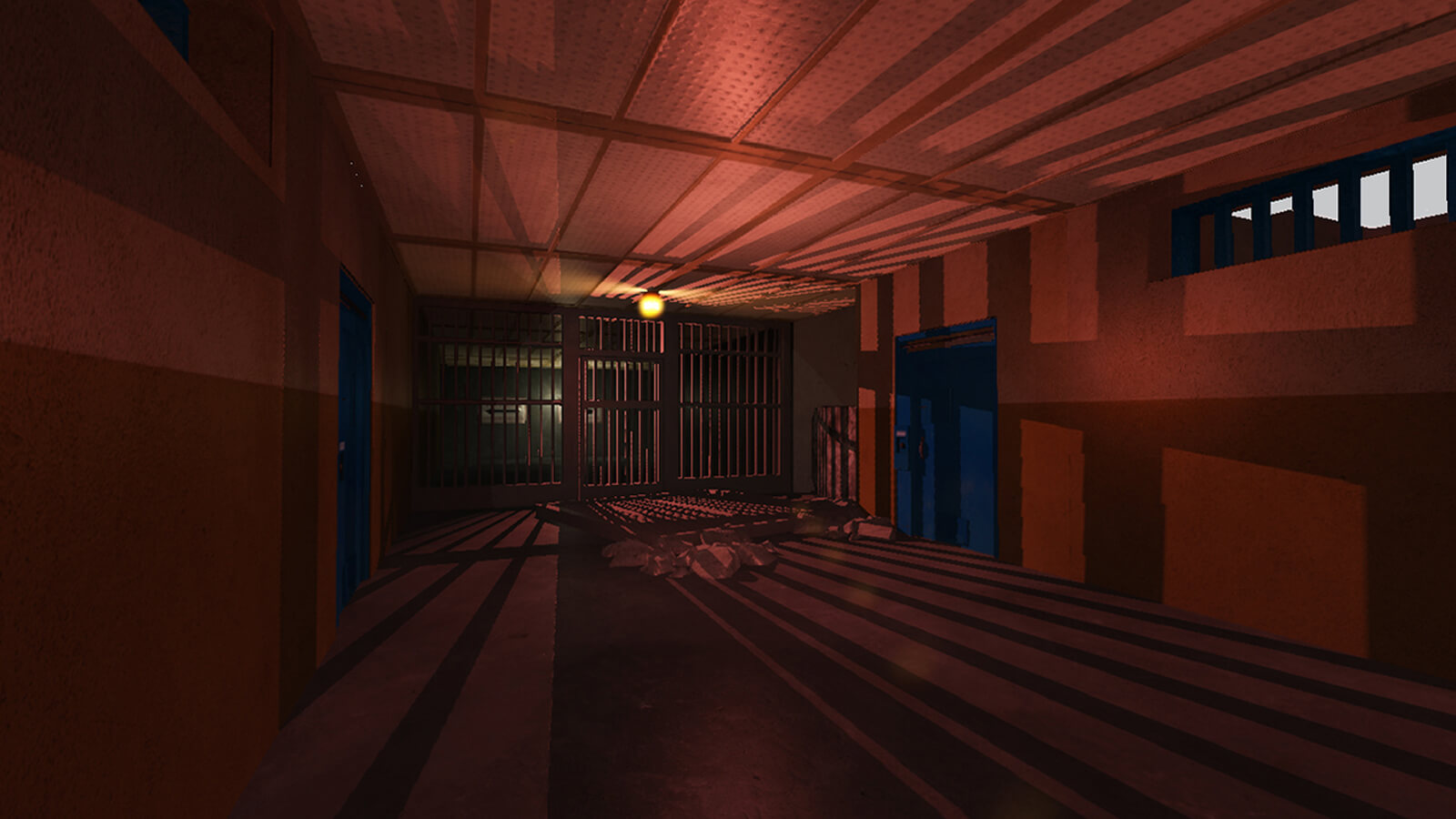 A dark hallway ending at a closed off by a barred door casting long reddish shadows across the floor and ceiling