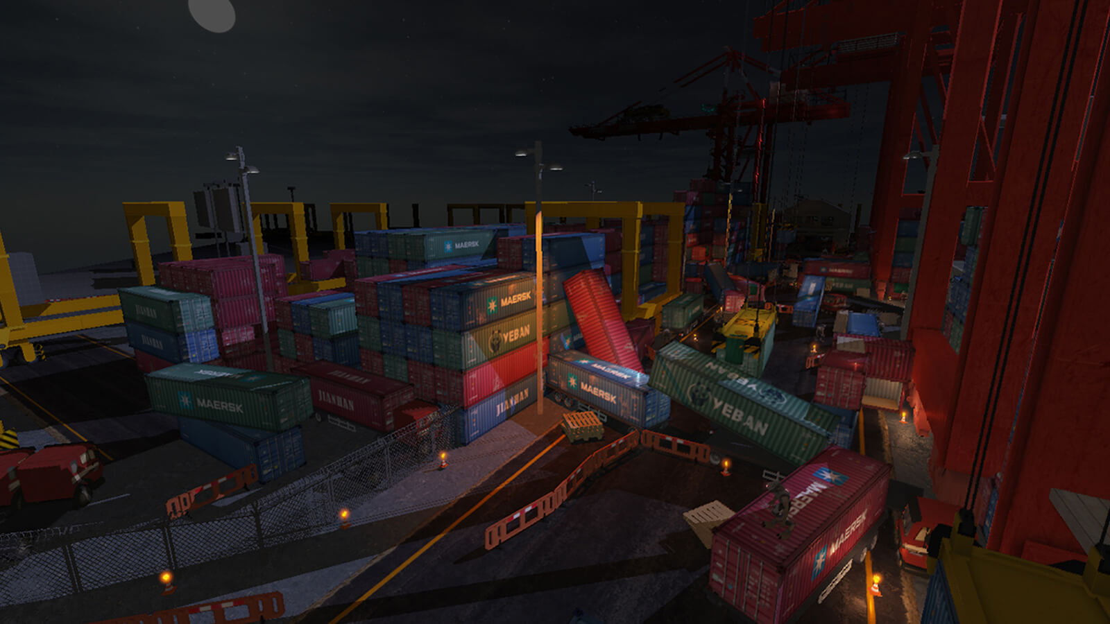 Dozens of shipping containers are stacked at a darkened dock. Several containers have fallen haphazardly to the ground.