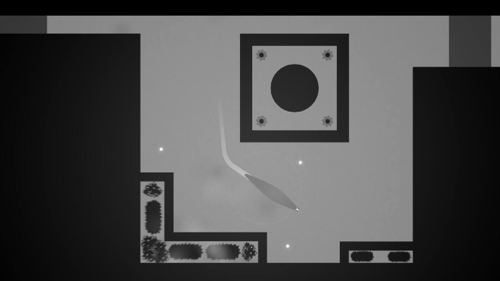 Seen from top down, a slug-like creature moves in an angular enclosed space all rendered in grayscale.