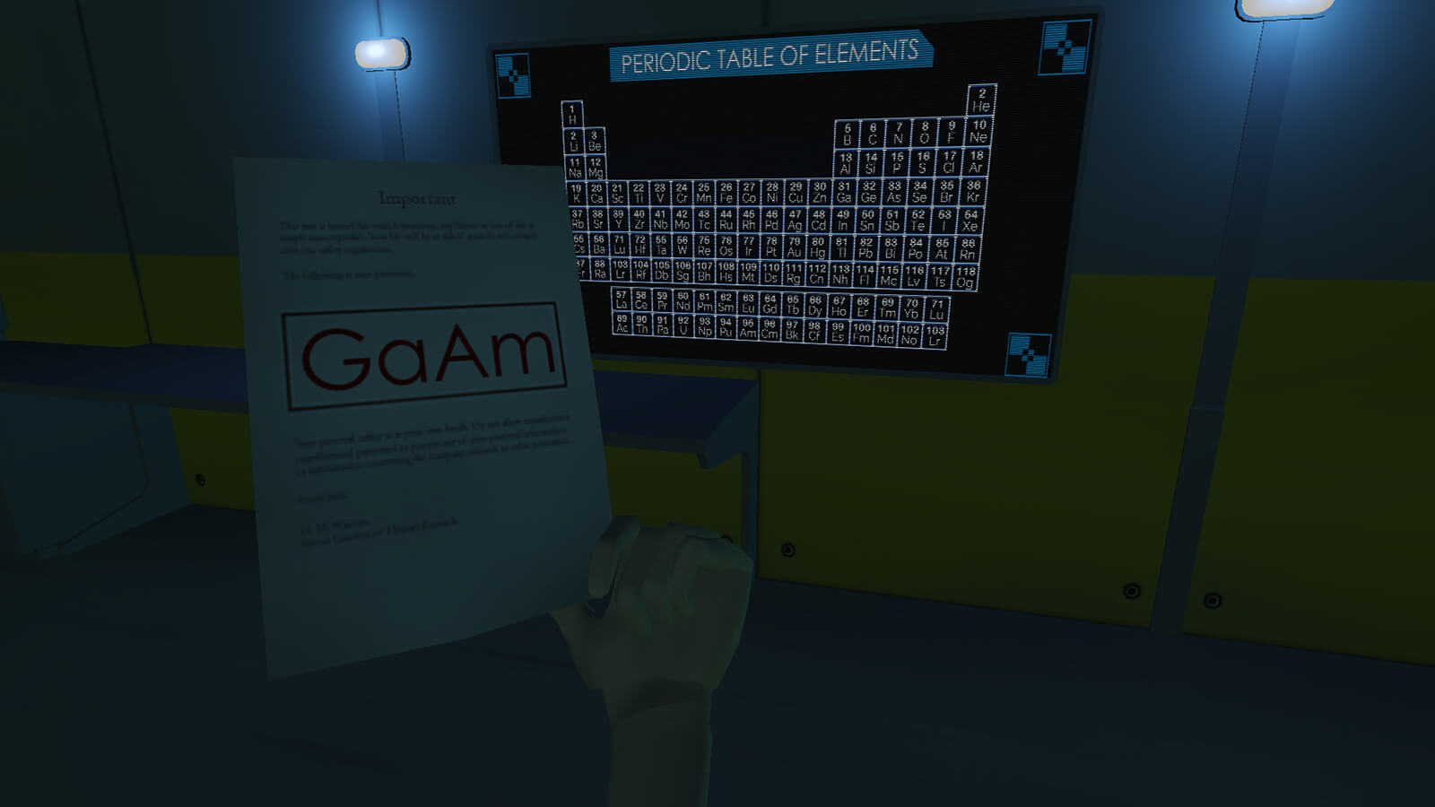 "In a dark room, a sheet of paper reading ""GaAm"" is held up to a black-and-blue Periodic Table of Elements poster on the wall."