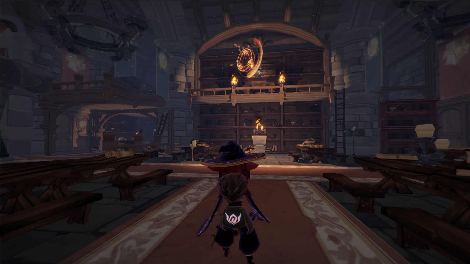 View of the player's character from behind standing in a torch-lit library with several tables and benches nearby