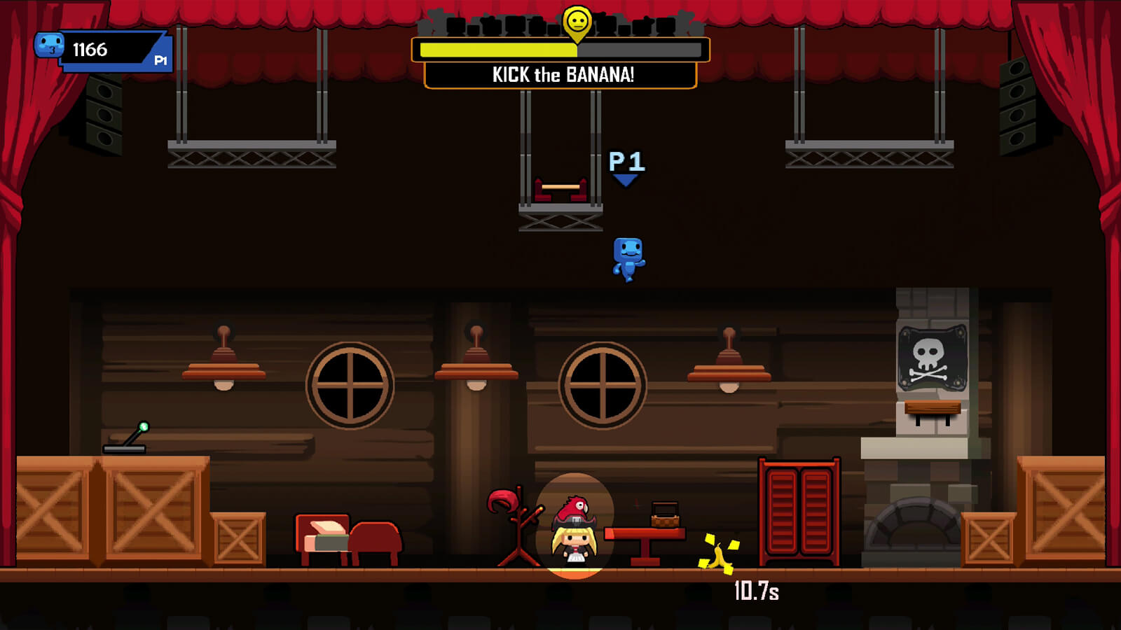 A blue player character leaps down onto a stage setting a pirate scene hoping to kick a banana