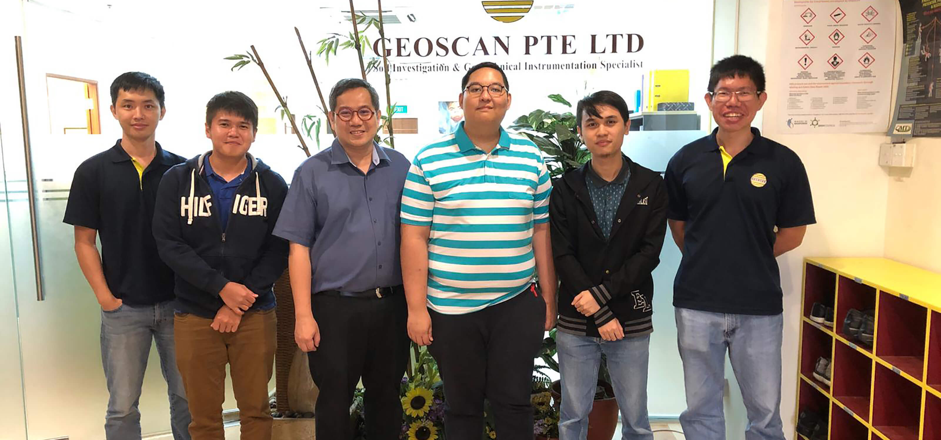 Group photo with SIT-DigiPen (Singapore) student interns Wazirullah Bin Rumzi and Zachary Ko with four Geoscan employees