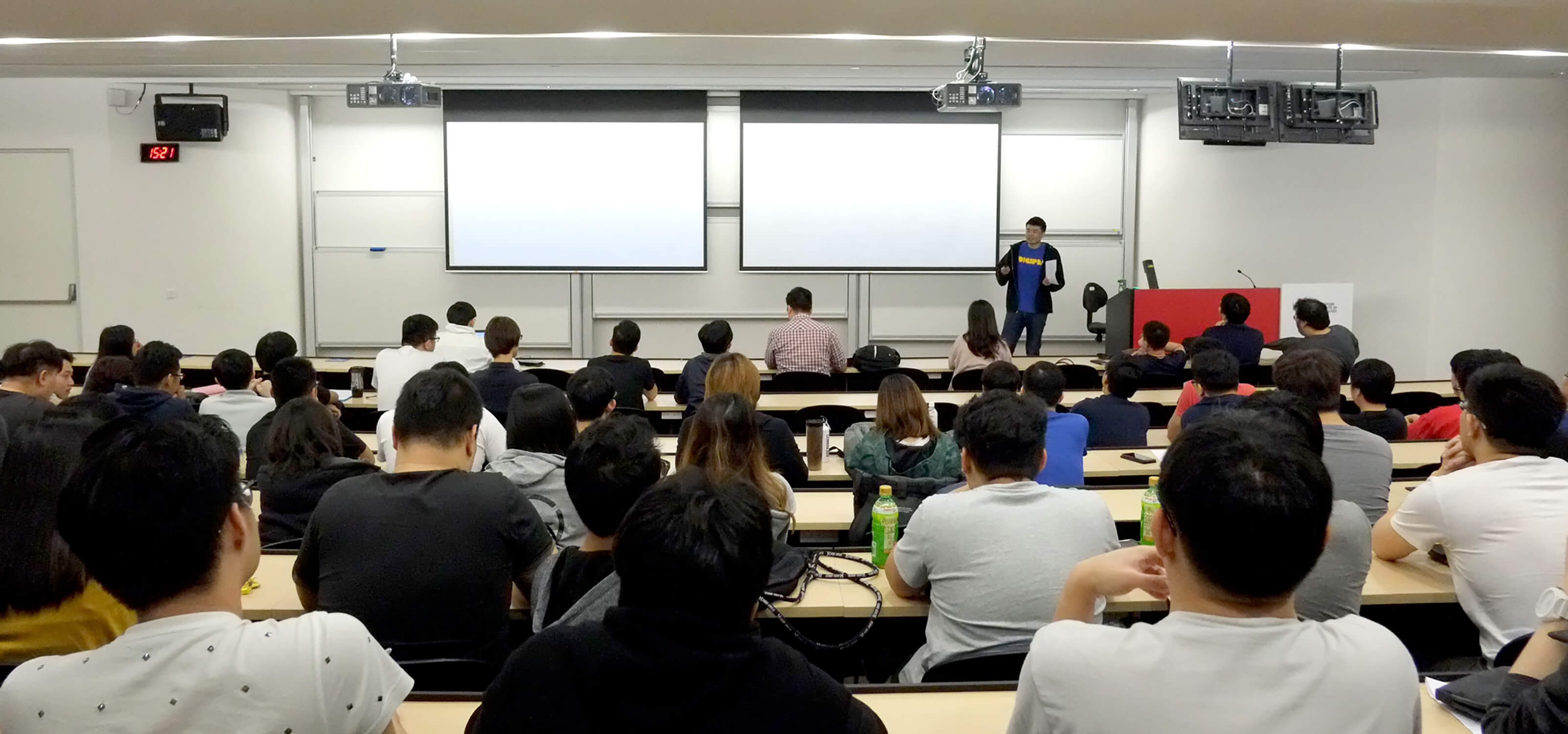 DigiPen (Singapore) BS in RTIS alumnus Tan Yao Wei speaks in front of a class