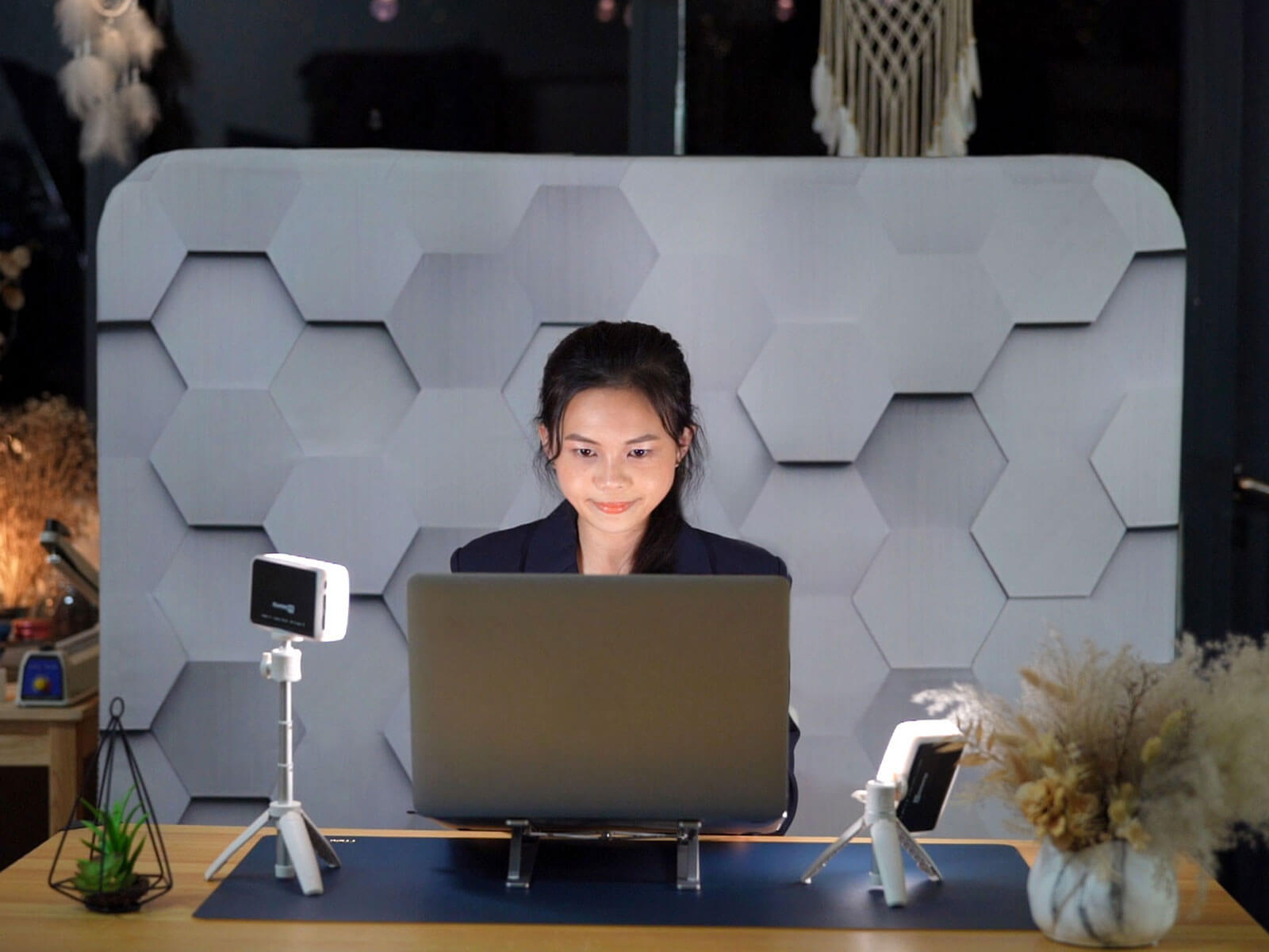 Woman using laptop and working from home.