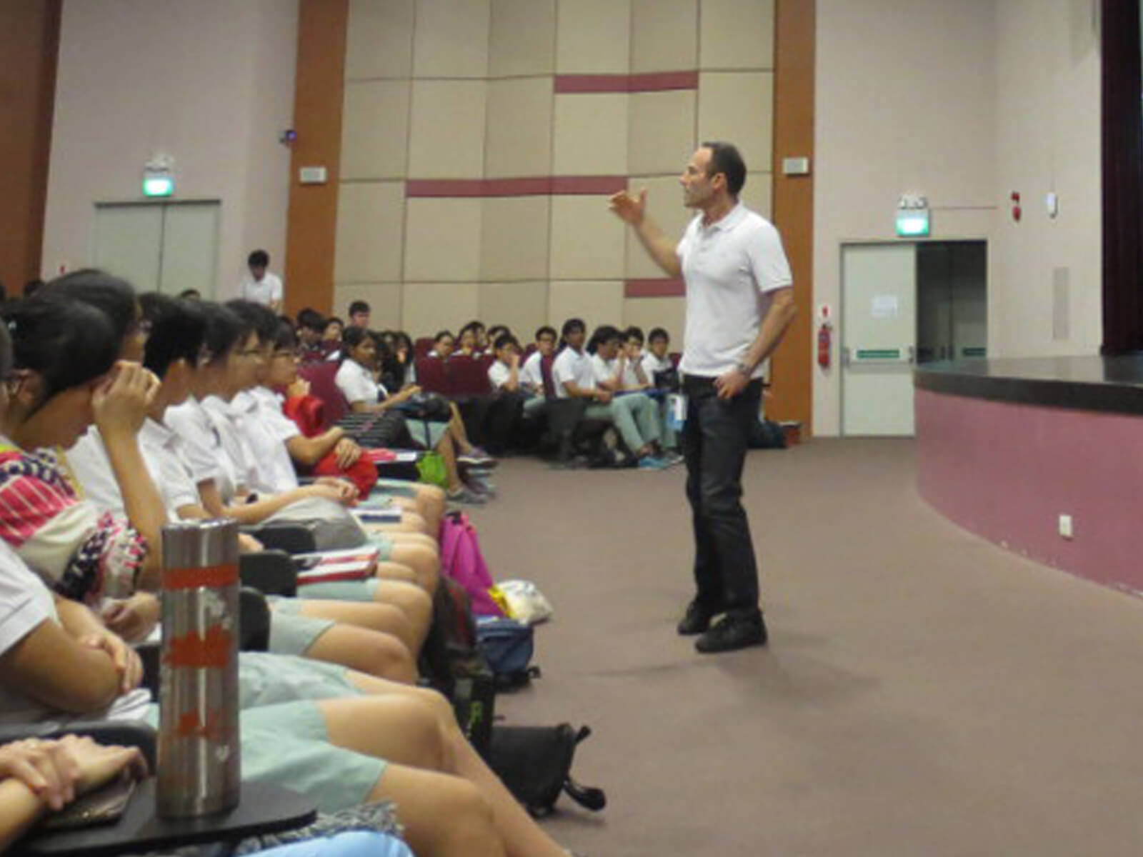 DigiPen CTO Samir Abou Samra speaks to students in a large presentation hall