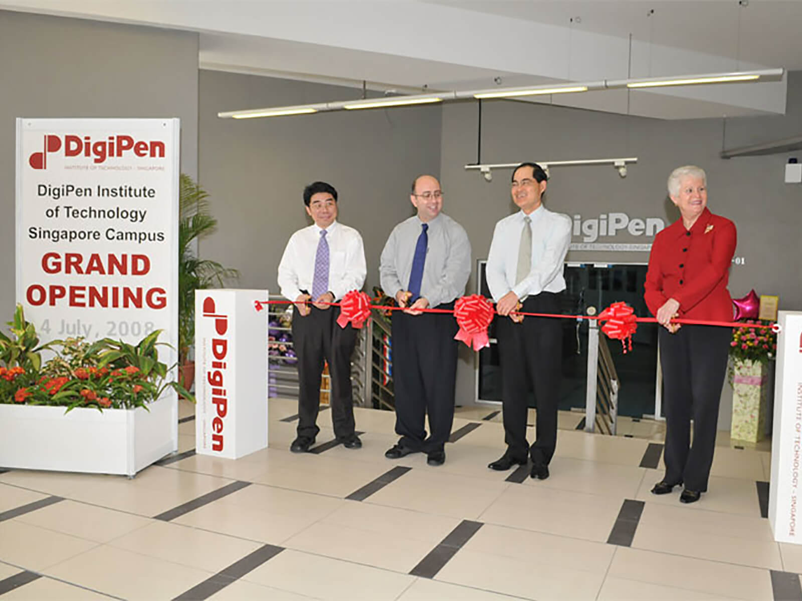 DigiPen COO Jason Chu and Founder Claude Comair cut the ribbon at the new DigiPen (Singapore) campus in 2008
