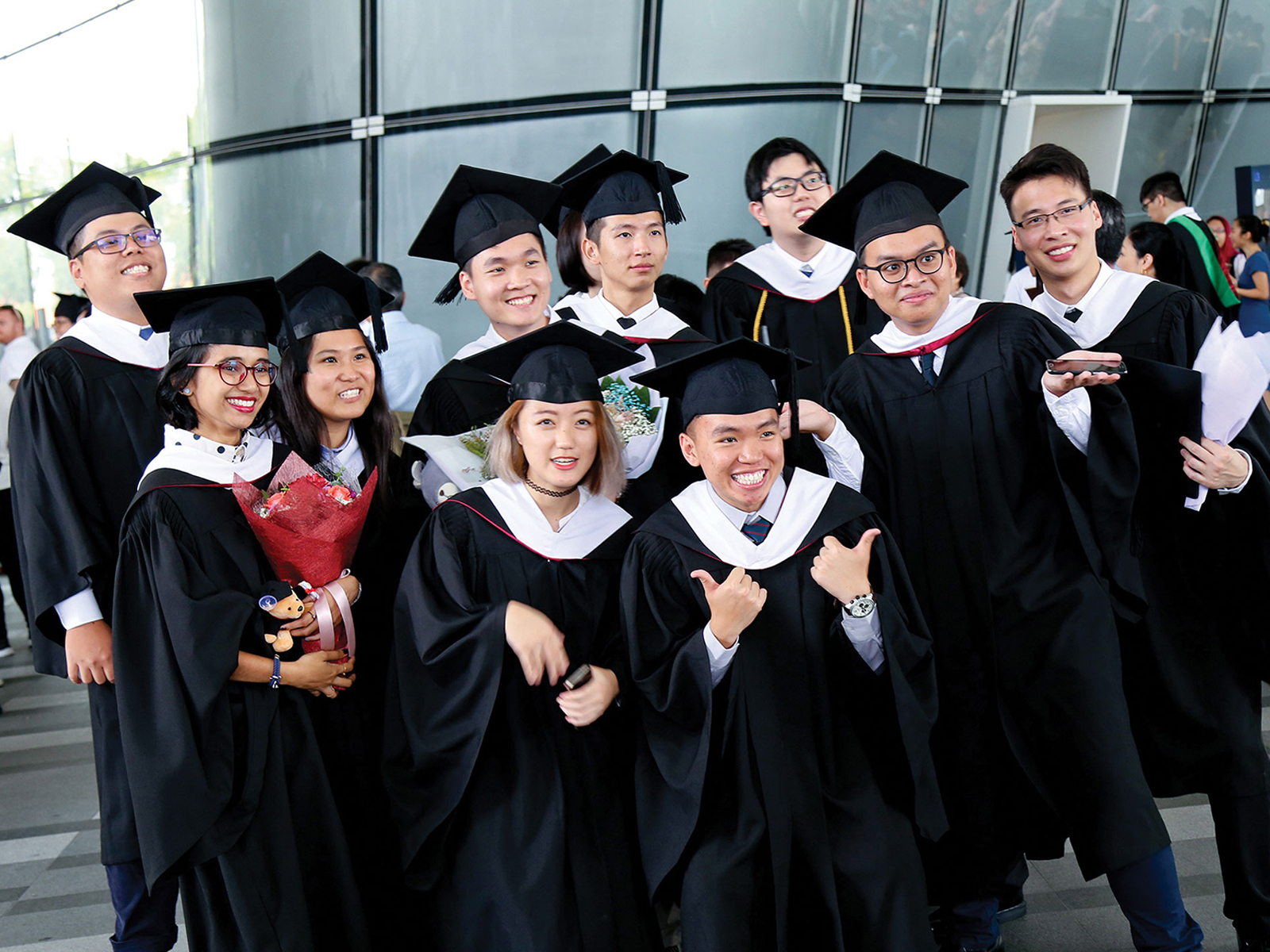 DigiPen (Singapore) graduates are all smiles at the 2017 commencement ceremony