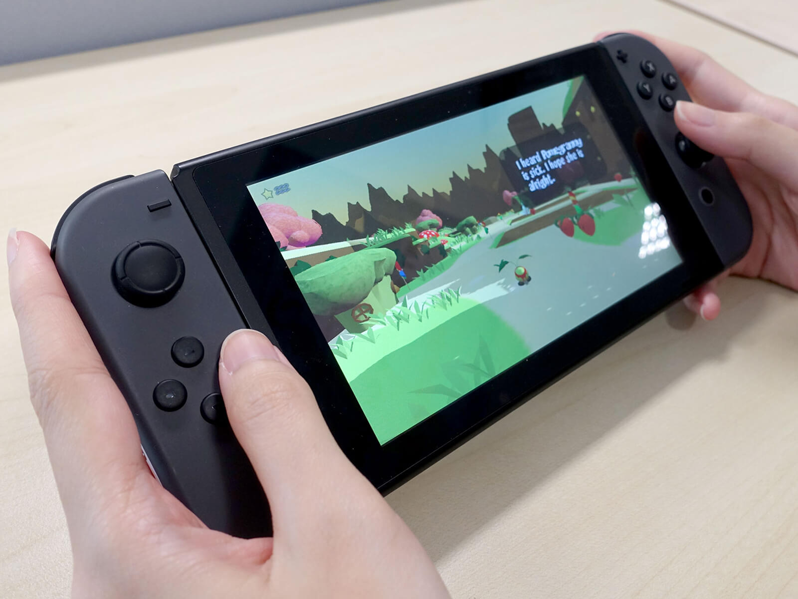 Close-up of two hands holding a Nintendo Switch