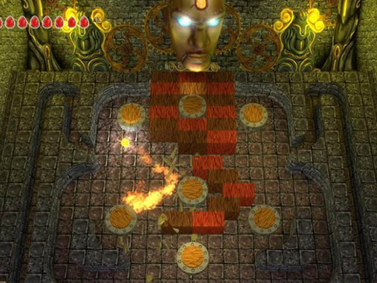 Screenshot from Terra, a ball of flame bounces off various bumpers in a dungeon-like pinball level