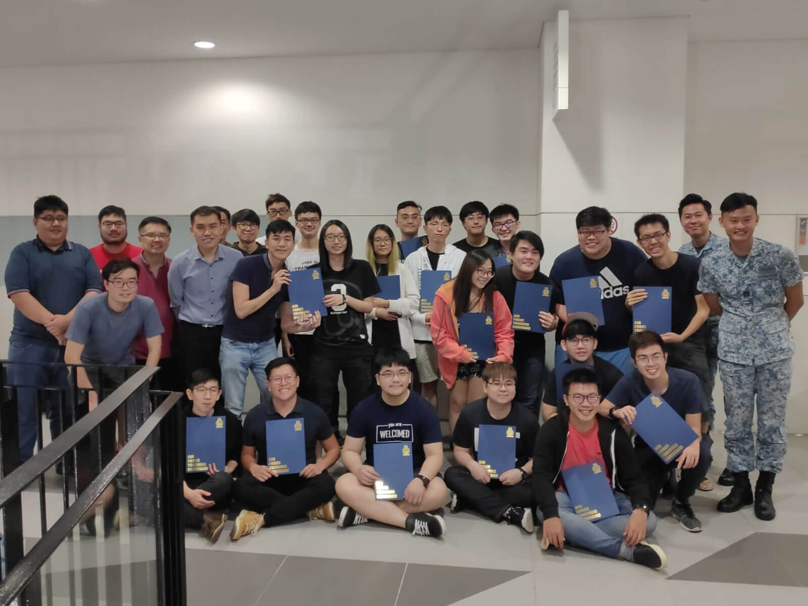 Group photo of 29 people, including DigiPen (Singapore) students and two instructors from the RSAF.