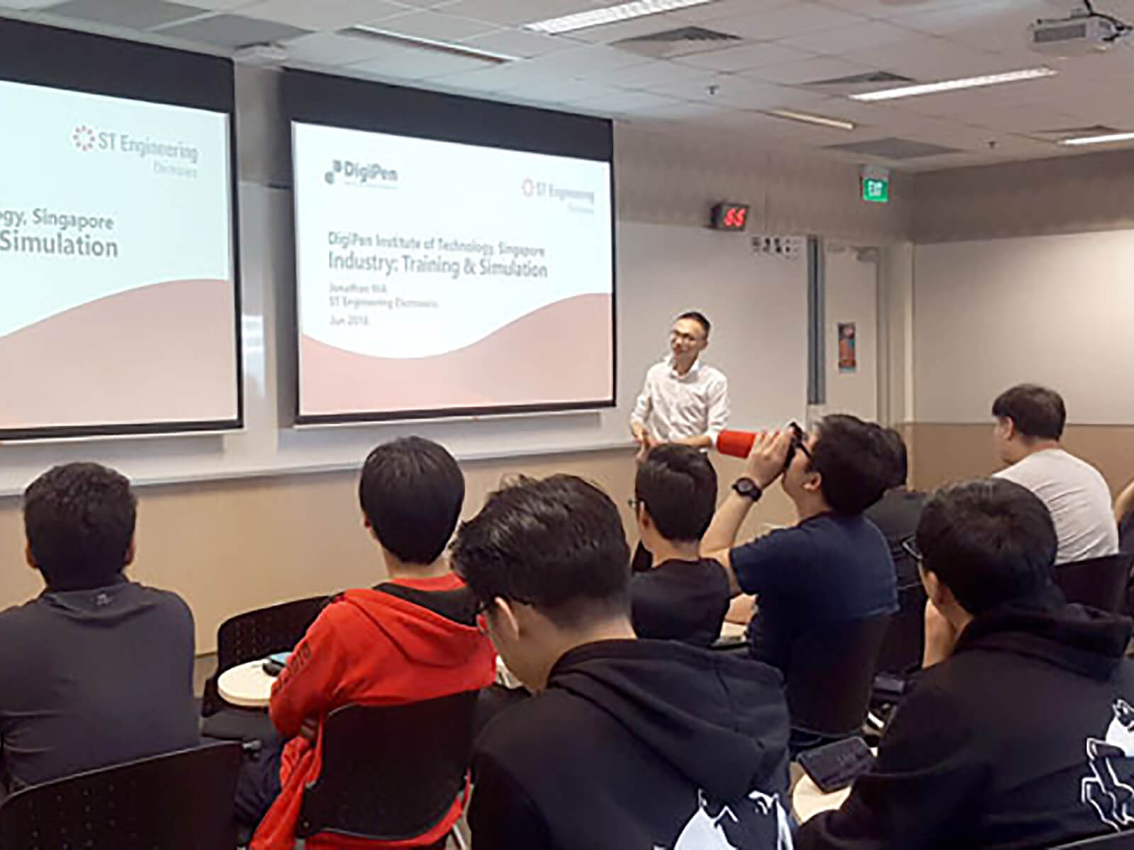 ST Engineering Assistant Division Manager Jonathan Hia speaks in front of a class of DigiPen (Singapore) students