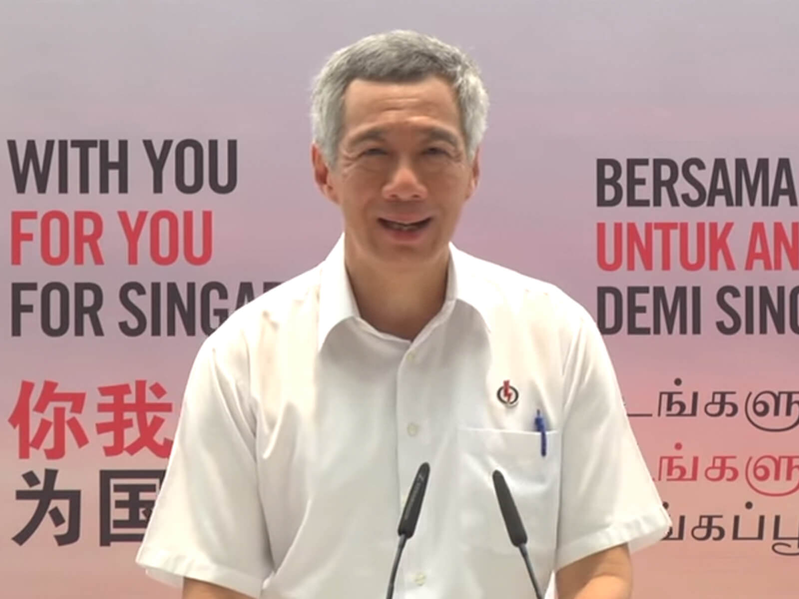 Singapore Prime Minister Lee Hsien Loong gives a speech in a white shirt