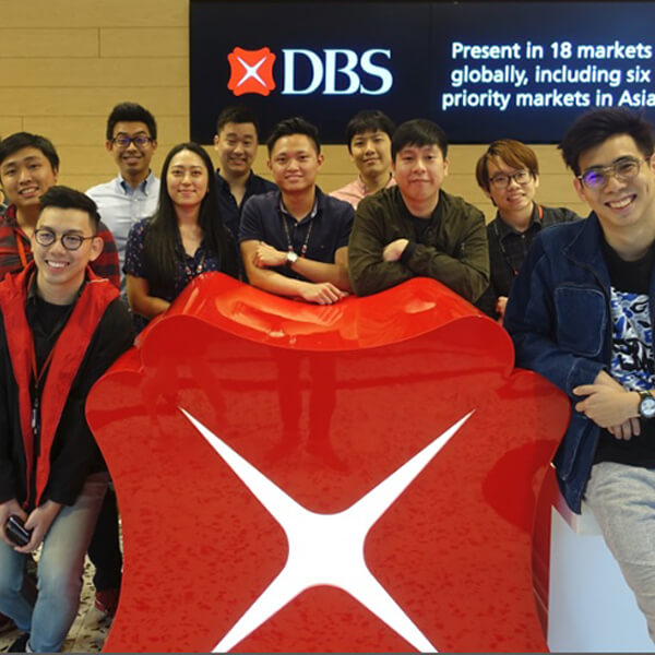 Group photo of 13 DigiPen (Singapore) alumni at DBS Bank