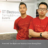 Terence Chow Shang Zhen and Tan Rijian pose in the ST Electronics lobby