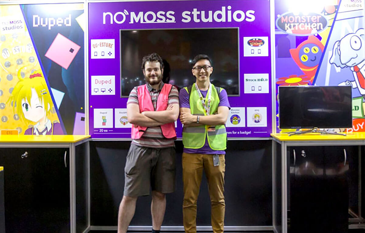 DigiPen (Sinagpore) alumnus Chen Zhiming poses with coworker Reuben Moorhouse at the No Moss Co convention booth