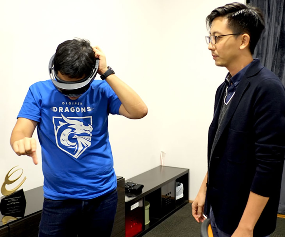 Two DigiPen (Singapore) alumni experiment with a virtual reality headset