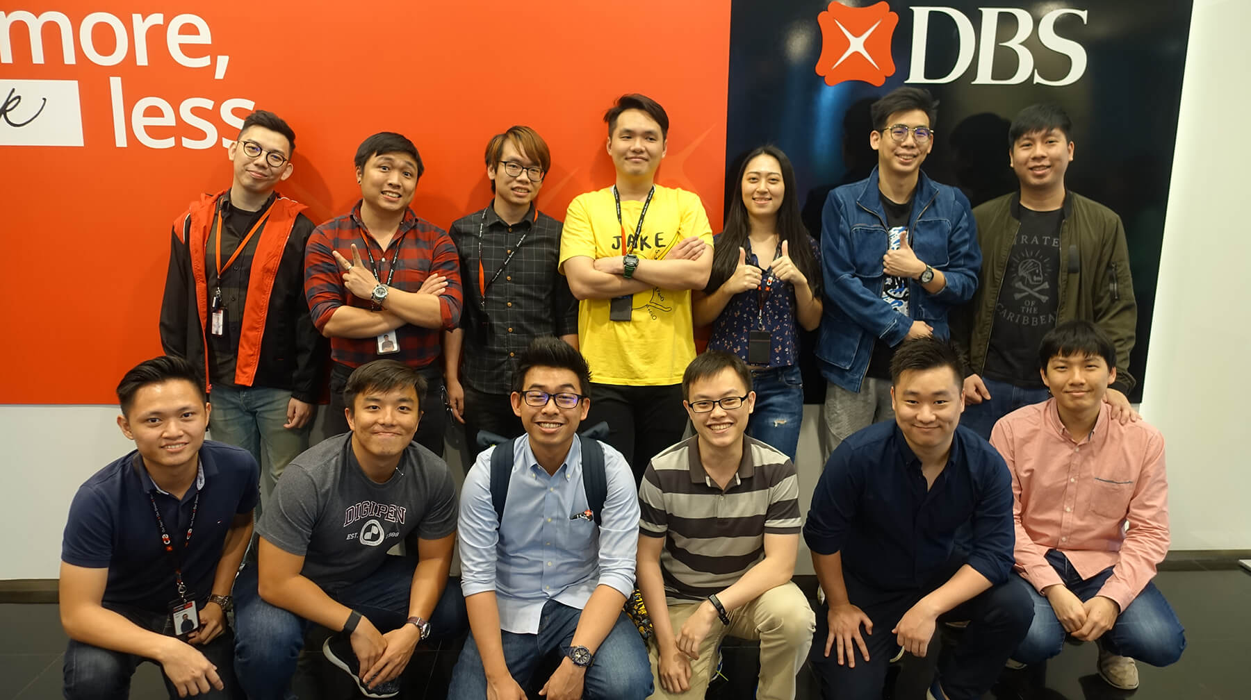 Group photo of 13 DigiPen (Singapore) graduates at DBS Bank