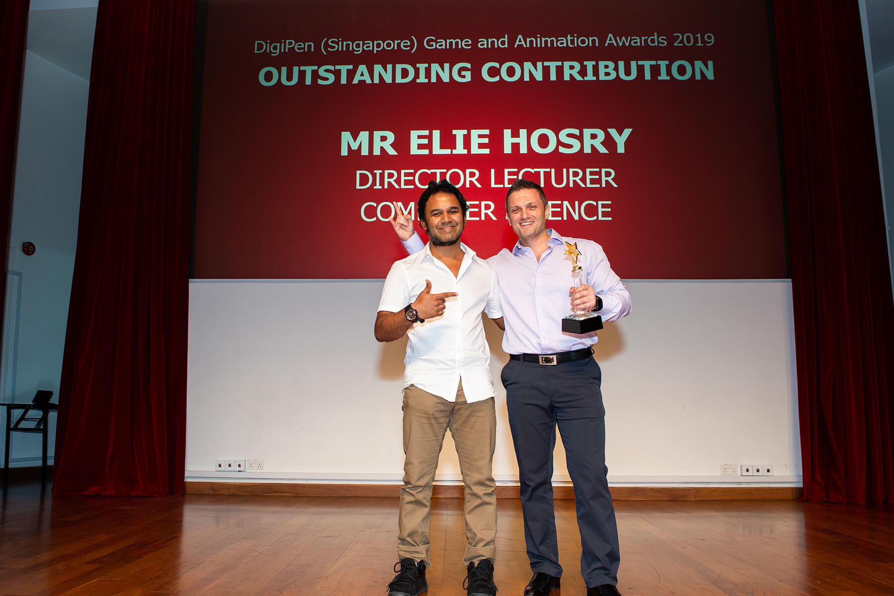 Elie Hosry accepts the Outstanding Contribution award for staff