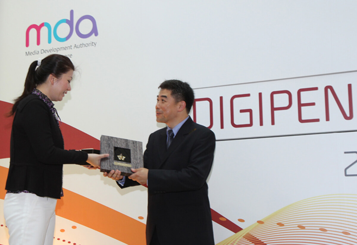 DigiPen Game Studios COO Jason Chu is presented with a plaque