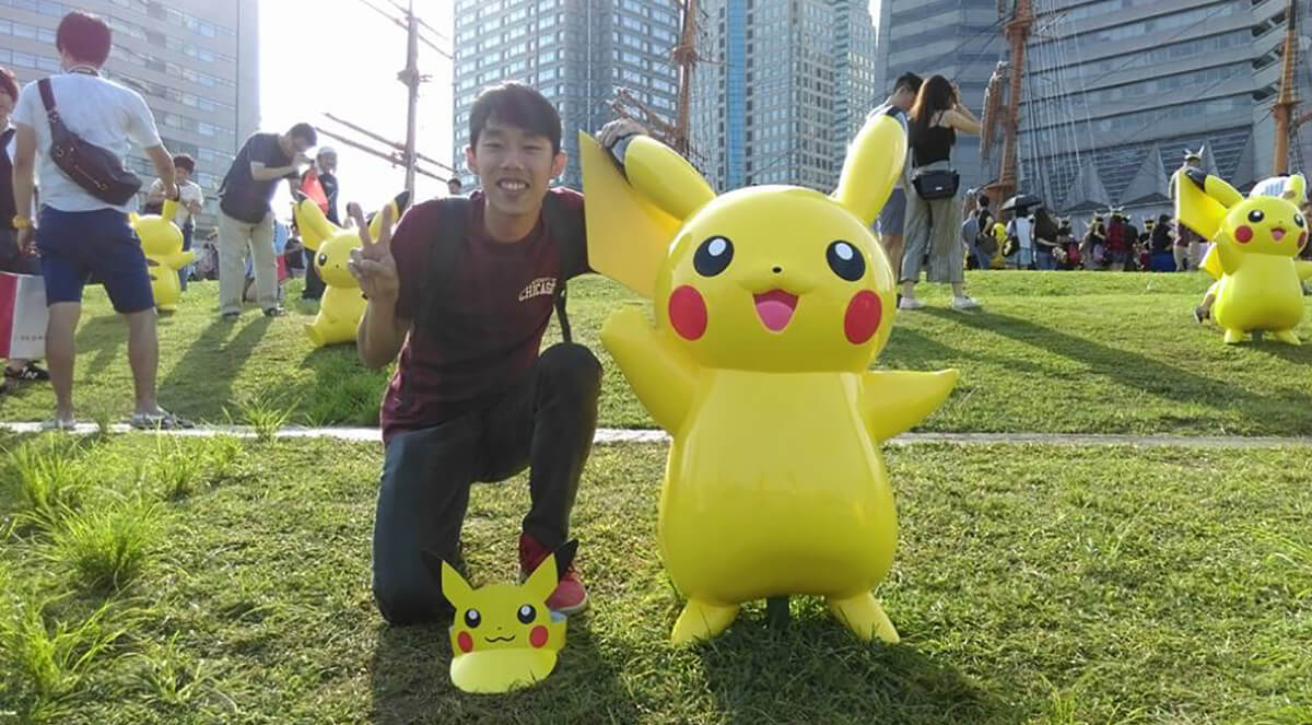 DigiPen (Singapore) alumnus Max Chew poses with Pikachu in Japan
